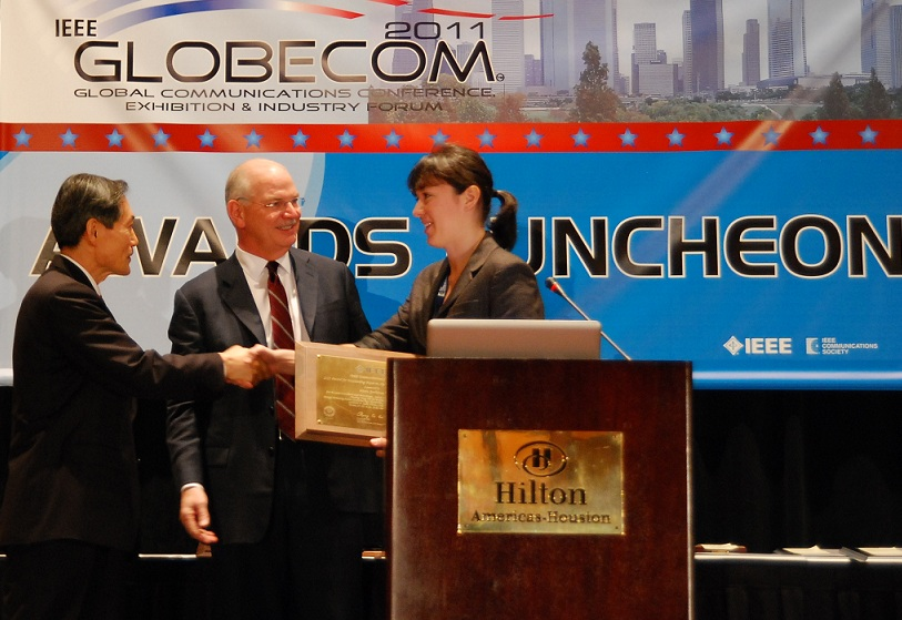 Receiving IEEE paper award at GLOBECOM 2011